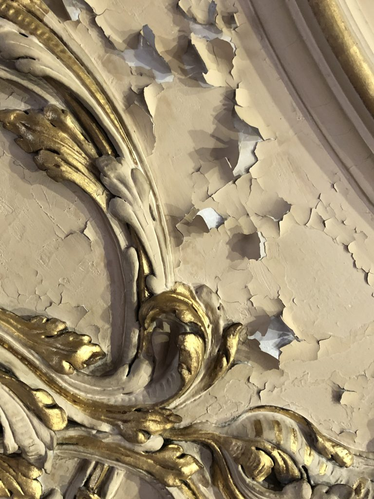 Flaking paint on the ceiling of the Great Hall