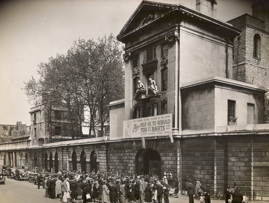 Henry VIII Gate with banner appeal to rebuild Barts