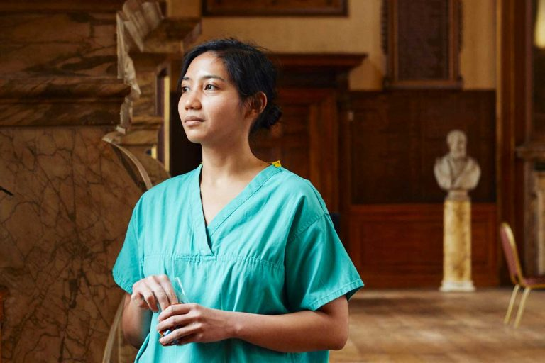 A member of the hospital team takes time out in the Great Hall