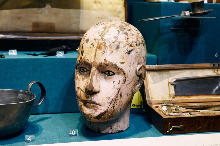 Wooden head used to practice drilling into the skull