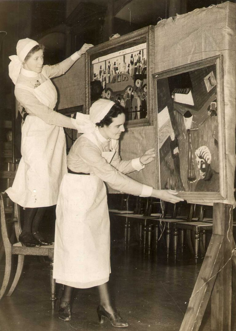 Nurses hanging an art exhibition in the Great Hall